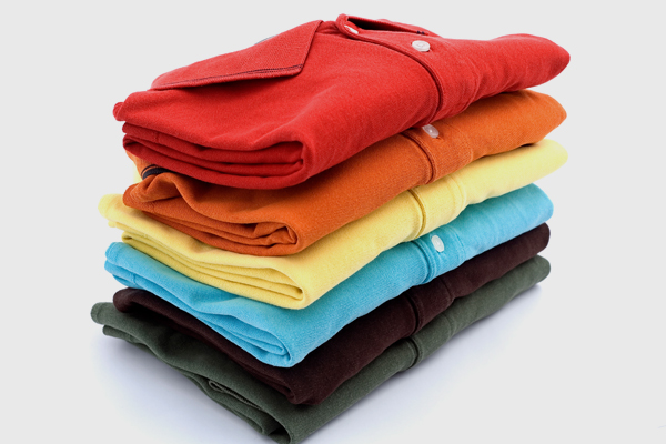 A stack of folded polo shirts.