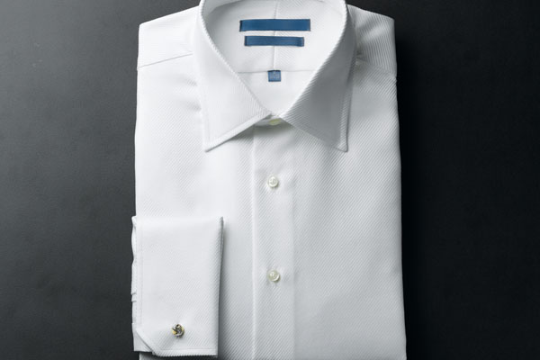 A man's pressed and folded white shirt