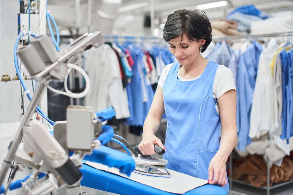 Employee ironing clothes